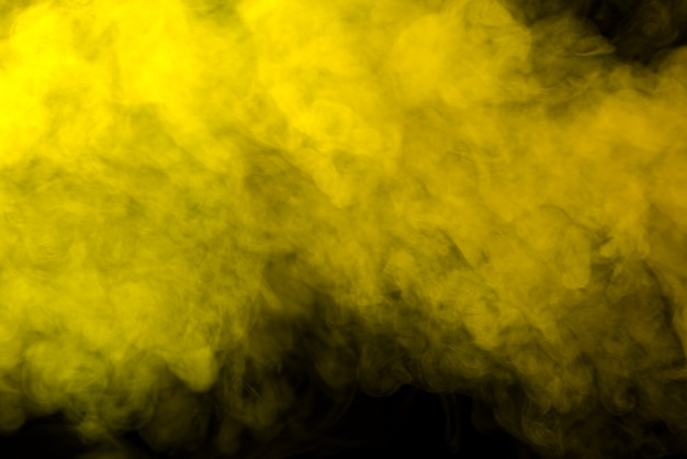 Yellow smoke on black background
