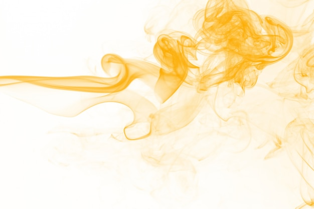 Yellow smoke motion abstract on white background