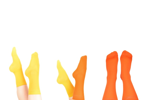 Yellow socks on woman foot isolated on white surface