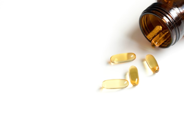 Yellow soft gelatin capsule with amber bottle