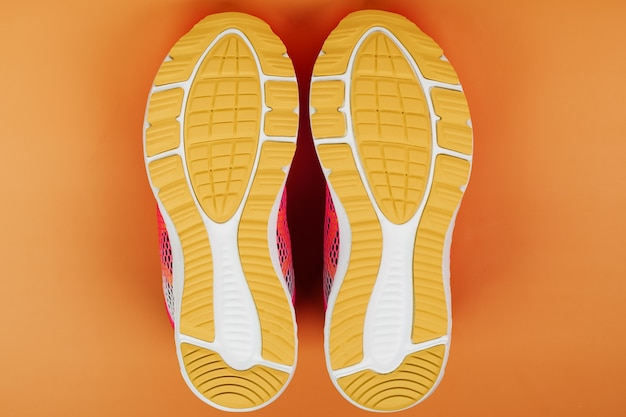 Yellow sole of a sneaker isolated on orange
