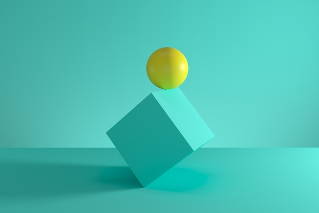 Yellow sphere on the edge of blue cube isolated on green background. minimal concept idea. 3d render.