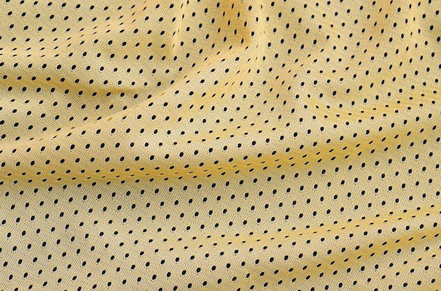 Yellow sport jersey clothing fabric texture and background with many folds