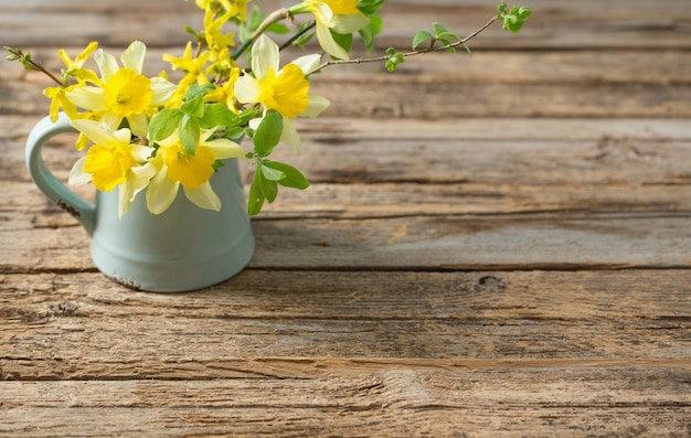 Yellow spring flowers on old wooden background