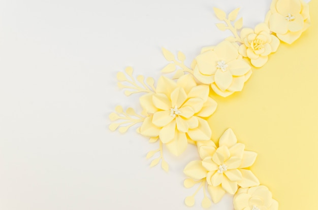 Yellow spring paper flowers on white background