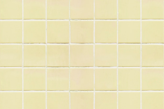 Priorità bassa di struttura piastrellata quadrata gialla