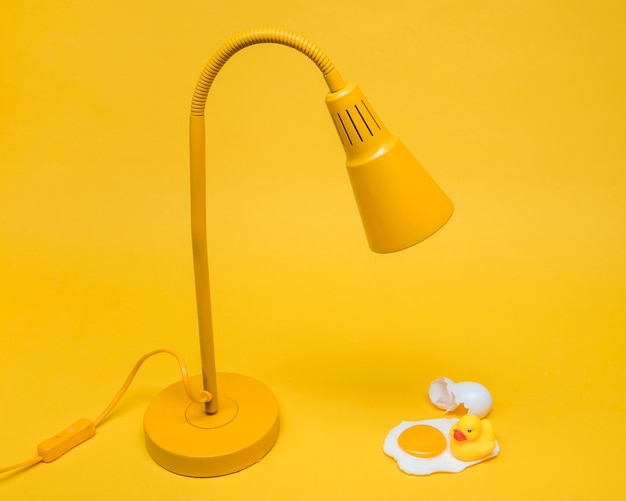 Yellow still life of egg under lamp