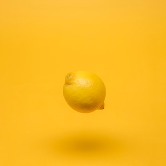 Yellow still life of floating lemon