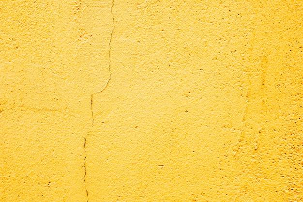 노란색 돌 벽 질감을 배경으로 사용할 수 있습니다.