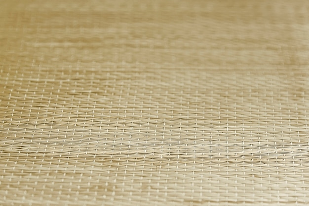 Yellow straw decorative mat background texture