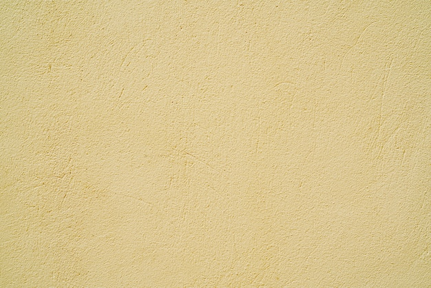 Yellow stucco texture wall of building
