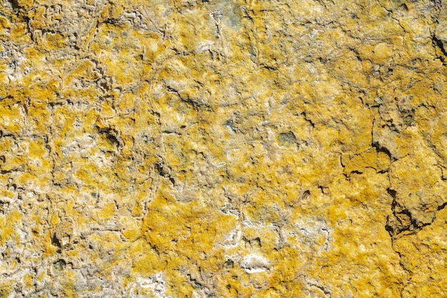 Yellow sulfur in crater of active volcano. natural geological pattern texture, volcanic sulphur background.