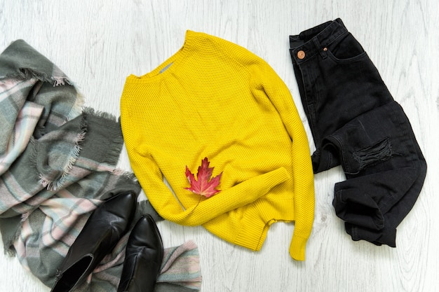 Yellow sweater, black jeans and scarf
