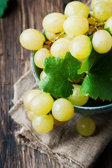 Yellow sweet grape on the wooden table