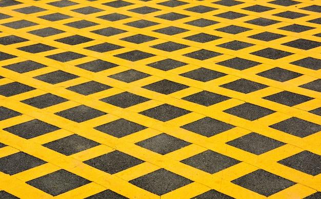 Yellow table symbol on asphalt road in urban