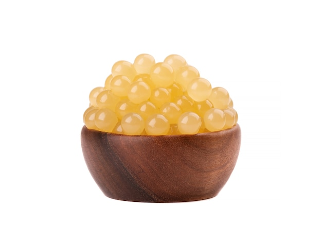 Yellow tapioca pearls for bubble tea isolated  tapioca pearls in wooden bowl.