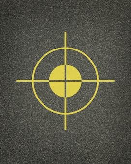 Желтая цель на текстуре асфальта