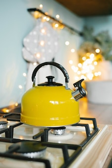 A yellow teapot stands on the stove in the kitchen