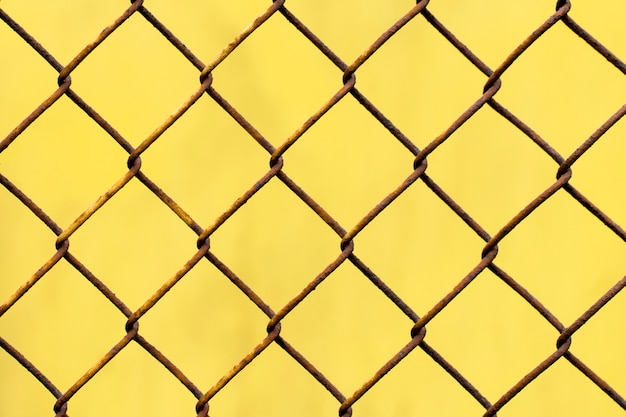 Yellow texture with rusty mesh