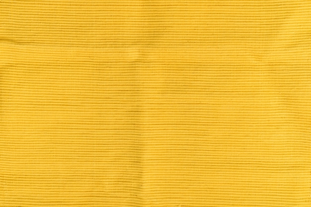 Yellow textured cotton fabric. ribbed texture. solid seamless background.
