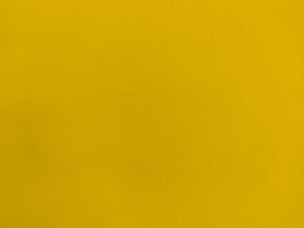 黄色のテクスチャ塗装壁の背景 Premium写真