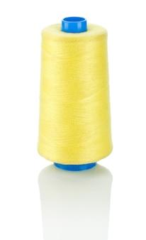青いスプールの黄色い糸