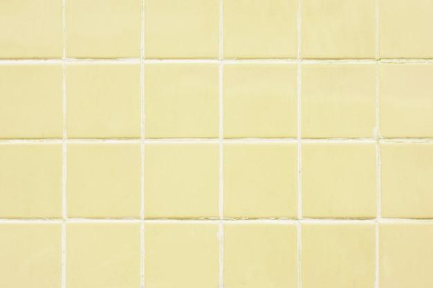 黄色のタイルの壁パターンの背景