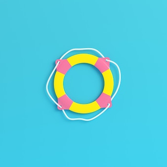 Yellow tlife buoy on bright blue background