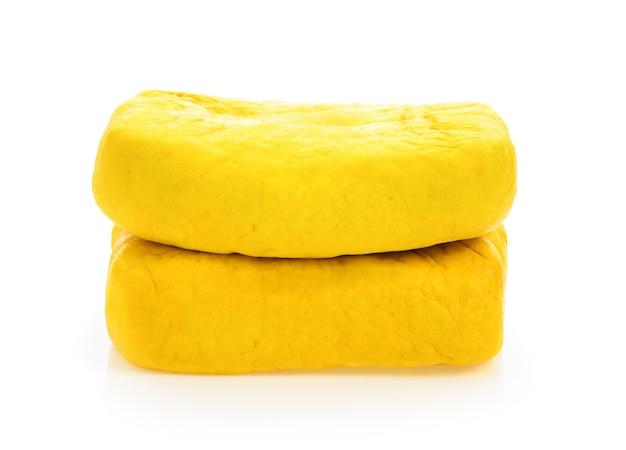 Yellow tofu on white background