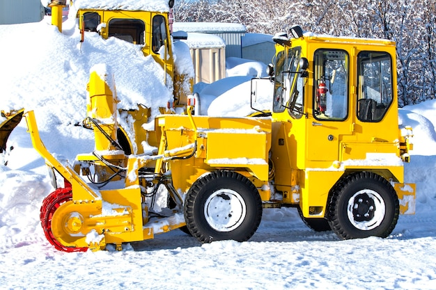 Yellow tractor for snow removal