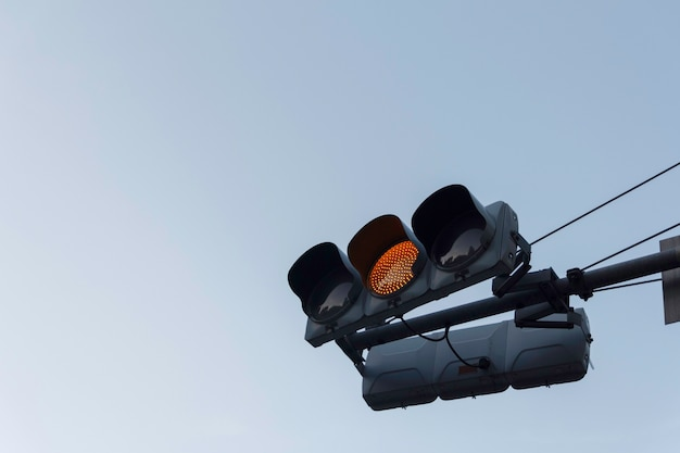 Yellow traffic light ,isolated on sky background