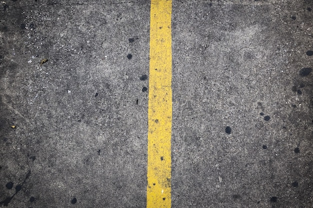 Yellow traffic line on the concrete road