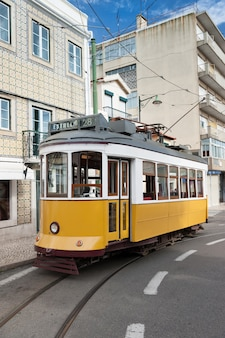 Yellow tram on the street in lisbon, portugal