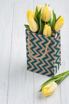 Yellow tulips in kraft package