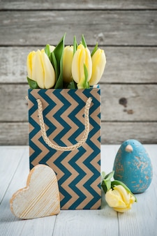 Yellow tulips in kraft package