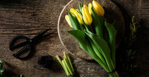 Yellow tulips on plate