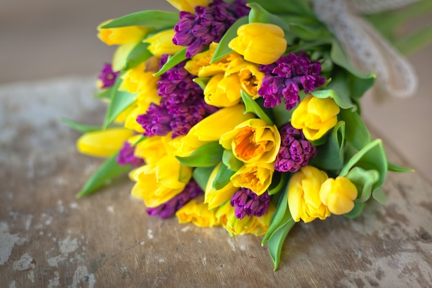 Yellow tulips and purple hyacinths flowers bouquet