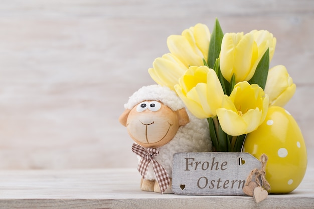 Yellow tulips, spring flowers and easter decoration