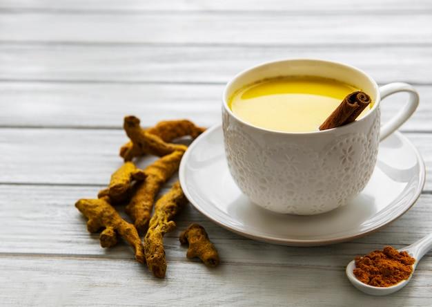 Yellow turmeric latte drink