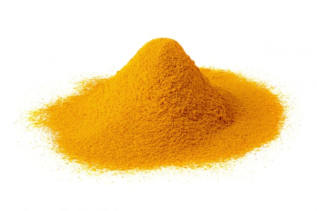 Yellow turmeric powder isolated on a white