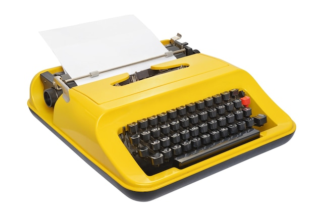 Yellow typewriter with german keyboard layout isolated