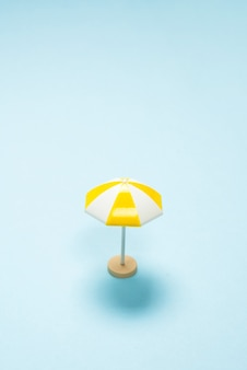 Yellow umbrella on a blue background. copy space.
