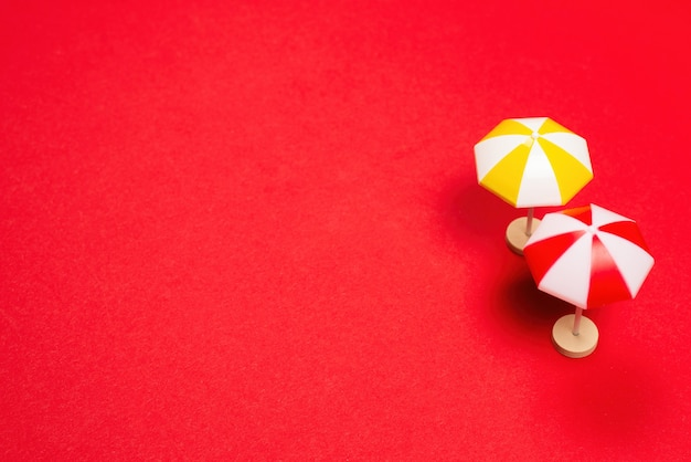 Yellow umbrella on a red background. copy space.