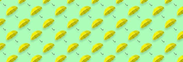Желтый зонтик бесшовные модели. фон зонтика. зонтик баннер.