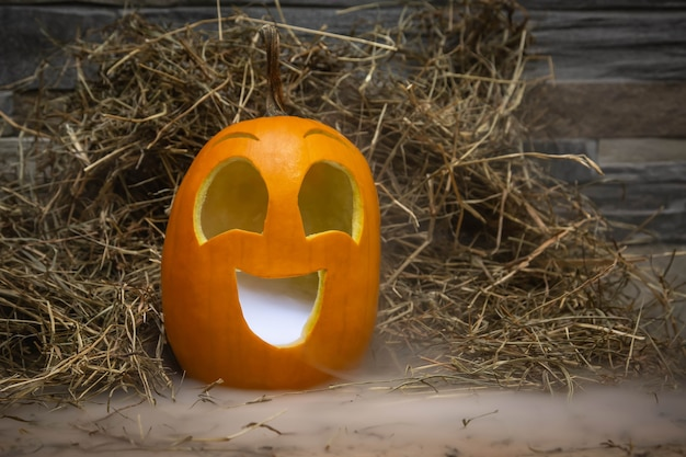 Yellow and very funny happy pumpkin for halloween celebration with smoke or vapor from the mouth