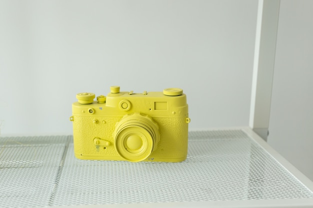 Yellow vintage camera minimal creative art concept photography and leisure concept