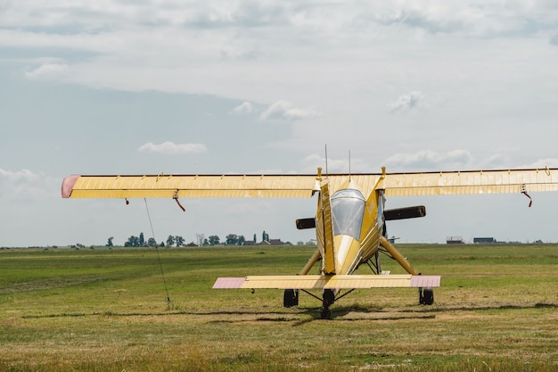 Yellow vintage plane on the airfield