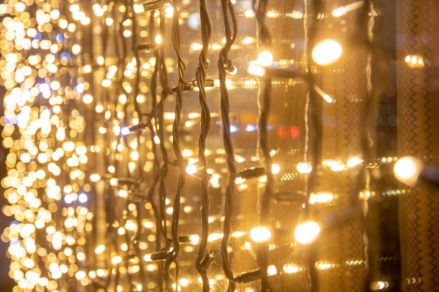 Yellow wall garland perspective close-up soft focus. festive blurred backdrop.