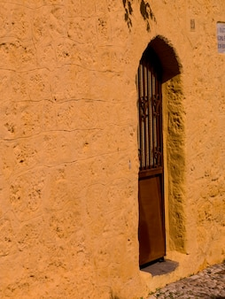 Yellow wall in rhodes greece