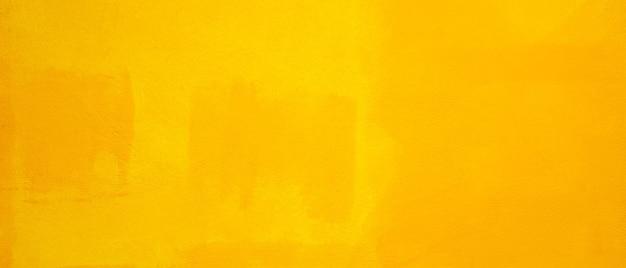 黄色の壁のテクスチャの背景。